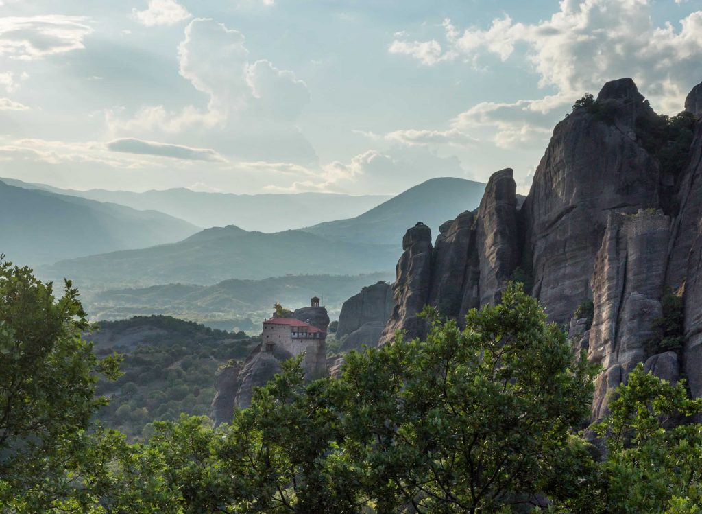 Meteora landscape in the sunset with rocks and clouds
