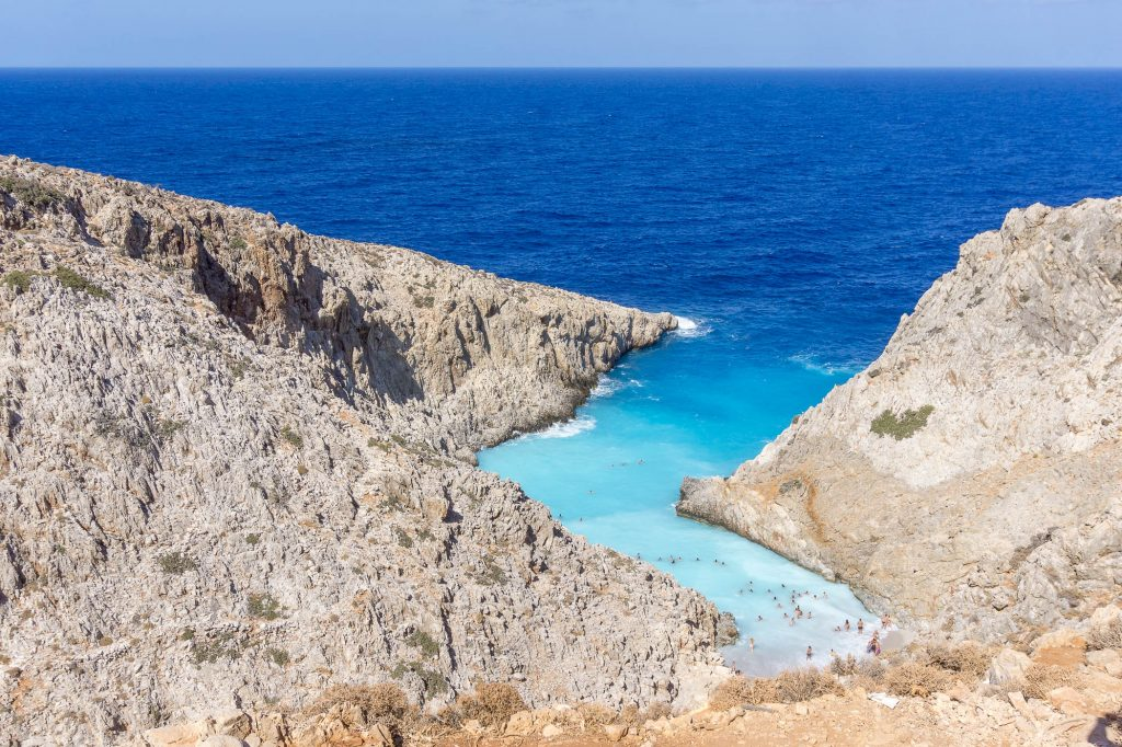 Seitan Limania is one of the most spectacular beaches in Chania, Crete. You can get there by car and by climbing down a steep mountain trail.