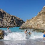 Seitan Limania Beach in Chania, Crete, is like a natural wave pool with emerald water