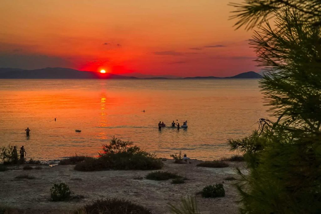 aegina sunset people sea