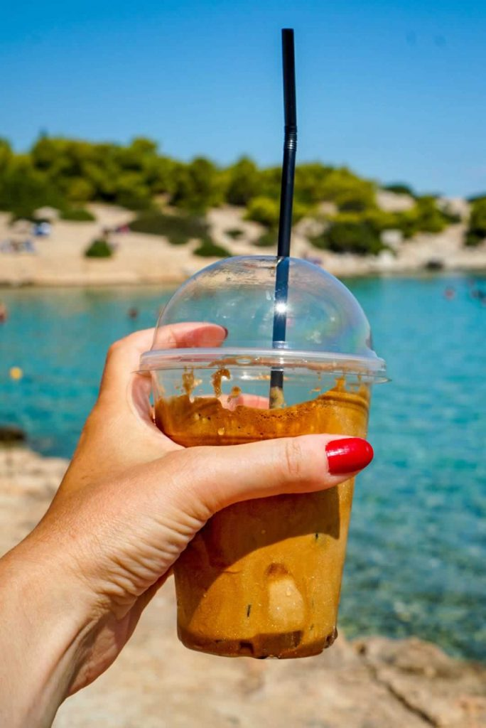 Greek Frappe in Hand with Red Nails