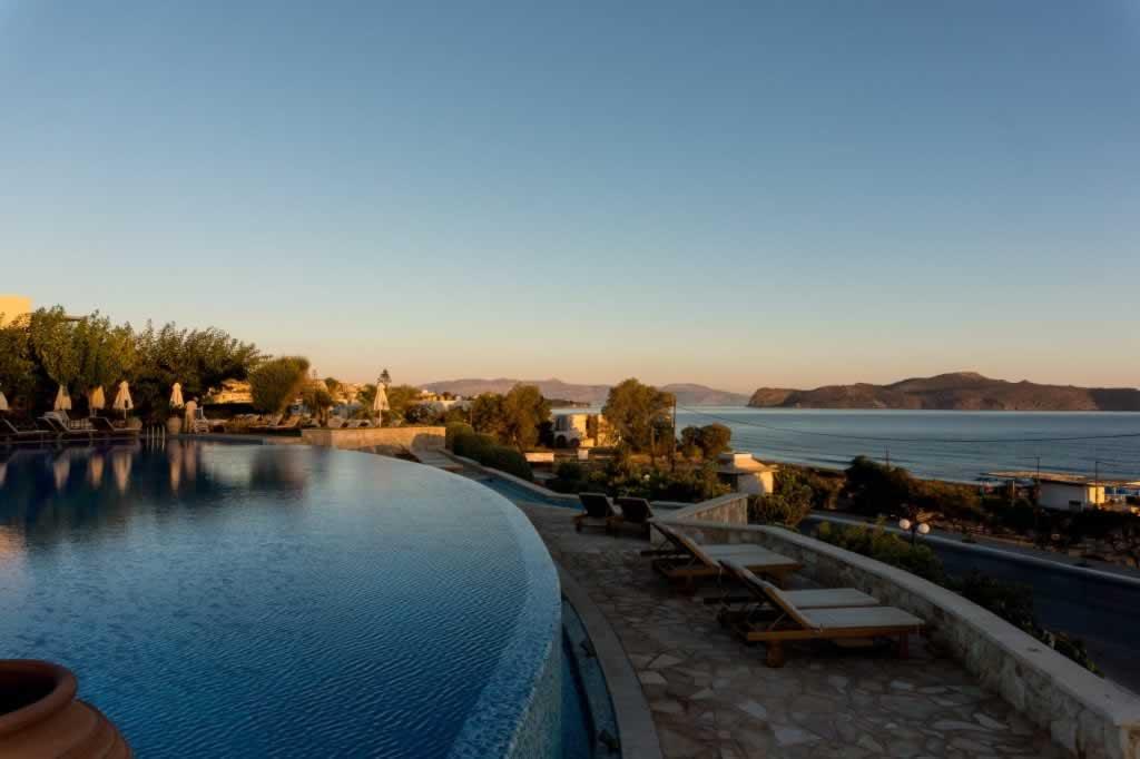 Cretan hotel infinity pool sunset