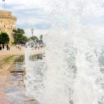 Gushing surf of a wave smashing against seaport at Thessaloniki,