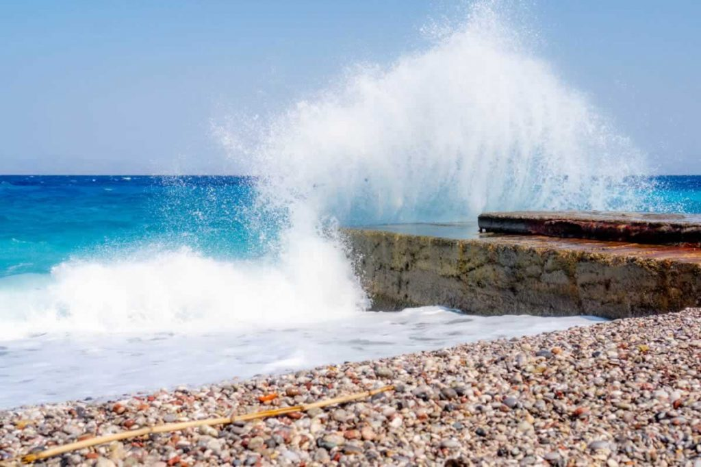 rhodes waves pebbles